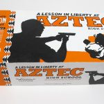 """closed box of """"A Lesson in Liberty at Aztec High School"""" boxed set containing eleven painted miniature figures, police SUV, and furniture by Matt Ferranto"""