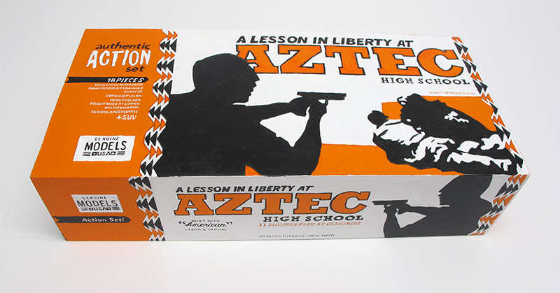 "closed box of ""A Lesson in Liberty at Aztec High School"" boxed set containing eleven painted miniature figures, police SUV, and furniture by Matt Ferranto"