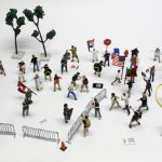 "detail of ""A Skirmish at Charlottesville,"" boxed set of 60 painted figures plus accessories, including house, trees, signs, street furniture by Matt Ferranto"