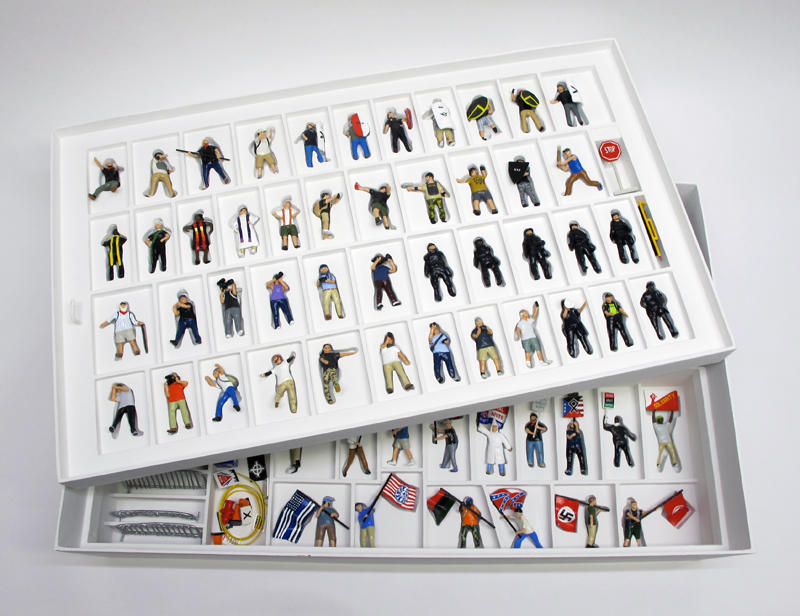 "opened box of ""A Skirmish at Charlottesville,"" boxed set of 60 painted figures plus accessories, including house, trees, signs, street furniture by Matt Ferranto"