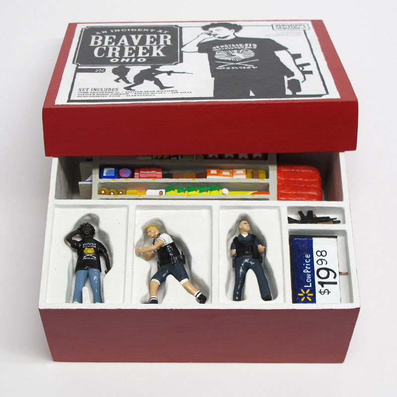 "opened box of ""An Incident at Beaver Creek"" boxed set containing three miniature figures, and retail sales shelf by Matt Ferranto"