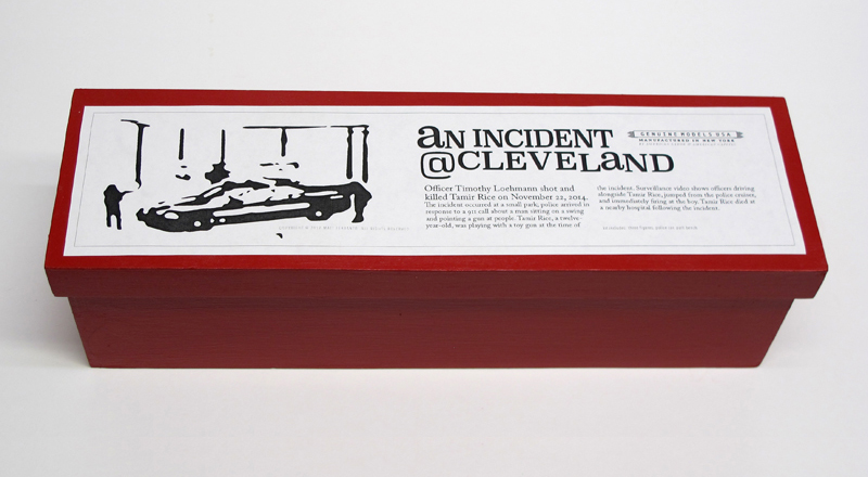 "closed box of ""An Incident at Cleveland"" boxed set containing three miniature figures, police car, and bench by Matt Ferranto"