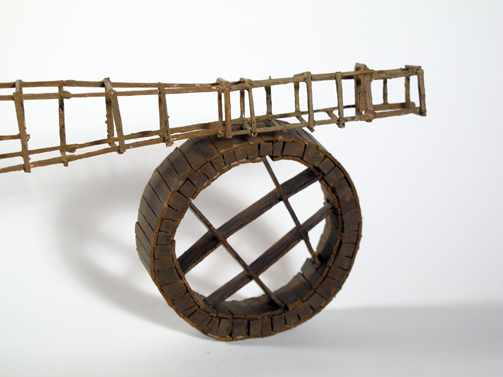 """detail of """"Brown Bomber"""" - painted miniature figure with wood scaffolding and wheel, by Matt Ferranto"""