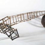 """Brown Bomber"" - painted miniature figure with wood scaffolding and wheel, by Matt Ferranto"