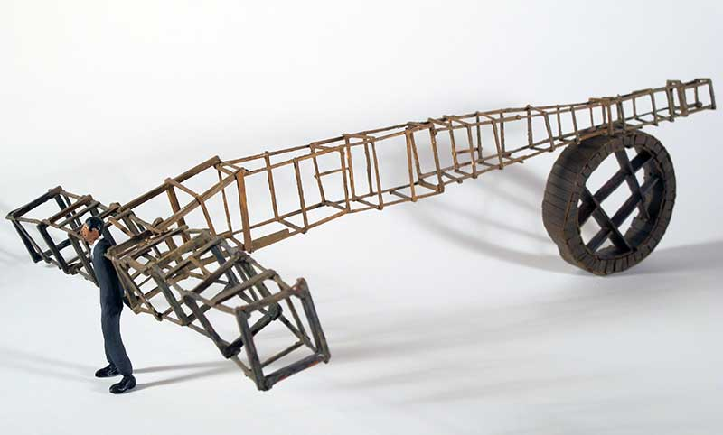 """""""Brown Bomber"""" - painted miniature figure with wood scaffolding and wheel, by Matt Ferranto"""