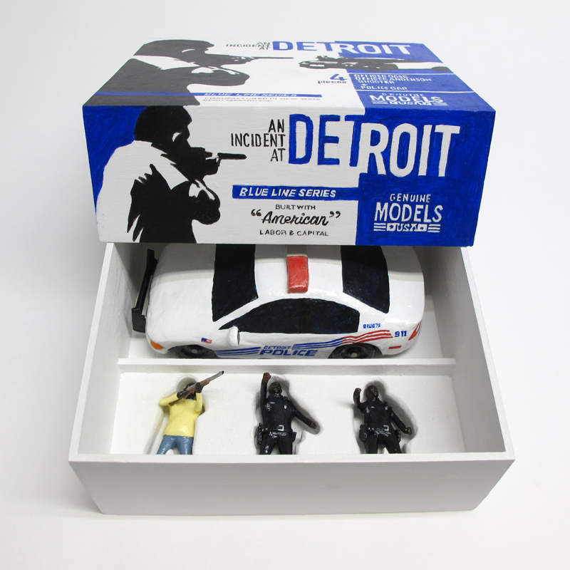 "open box of ""An Incident at Detroit,"" boxed set with three painted figures and police car by Matt Ferranto"