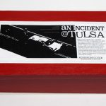 "closed box of ""An Incident at Tulsa,"" boxed set with five painted figures, SUV, and police car by Matt Ferranto"