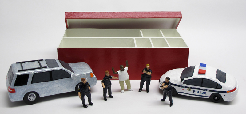 "open box of ""An Incident at Tulsa,"" boxed set with five painted figures, SUV, and police car by Matt Ferranto"