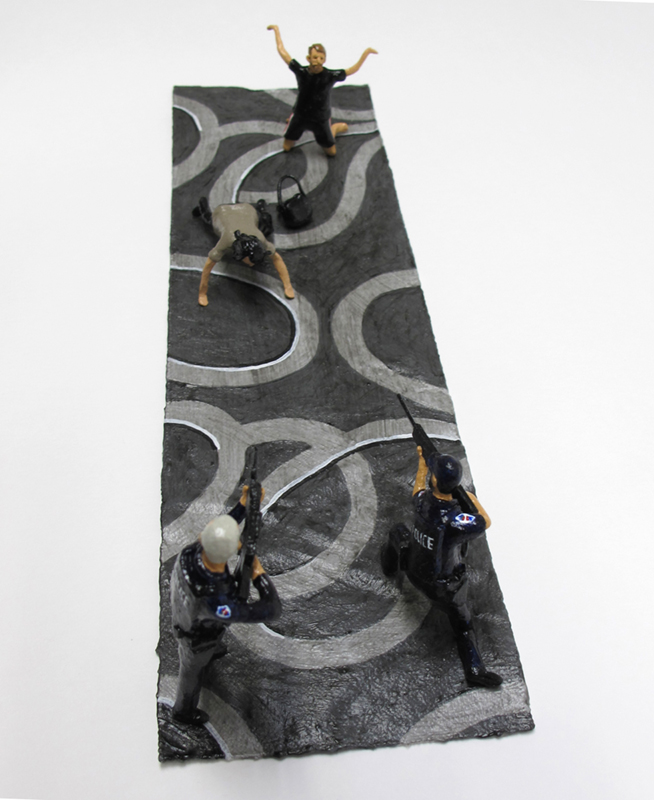 """detail of """"An Incident at Mesa,"""" boxed set with four painted figures plus accessories by Matt Ferranto"""