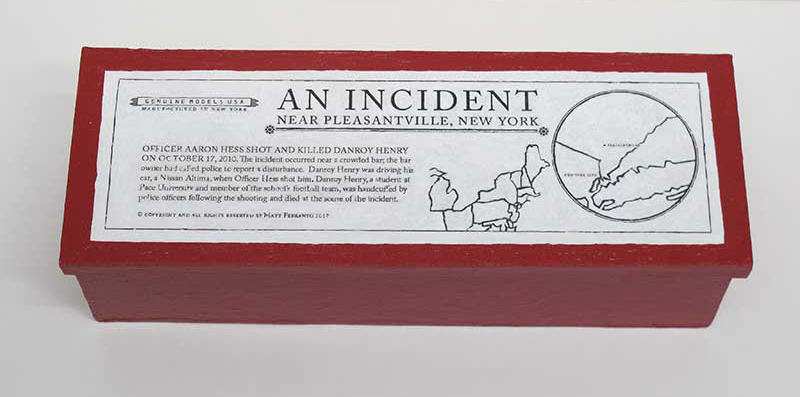 "closed box of ""An Incident near Pleasantville,"" boxed set with two painted figures, car, and accessories by Matt Ferranto"