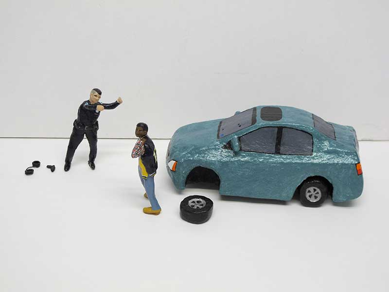 "detail of ""An Incident near Pleasantville,"" boxed set with two painted figures, car, and accessories by Matt Ferranto"