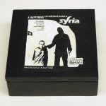 "closed box of ""A Happening at an Undisclosed Location in Syria,"" boxed set with two miniature painted figures plus accessories by Matt Ferranto"