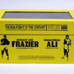 """closed box of """"The Real Fight of the Century,"""" boxed set with two painted figures plus boxing ring by Matt Ferranto"""