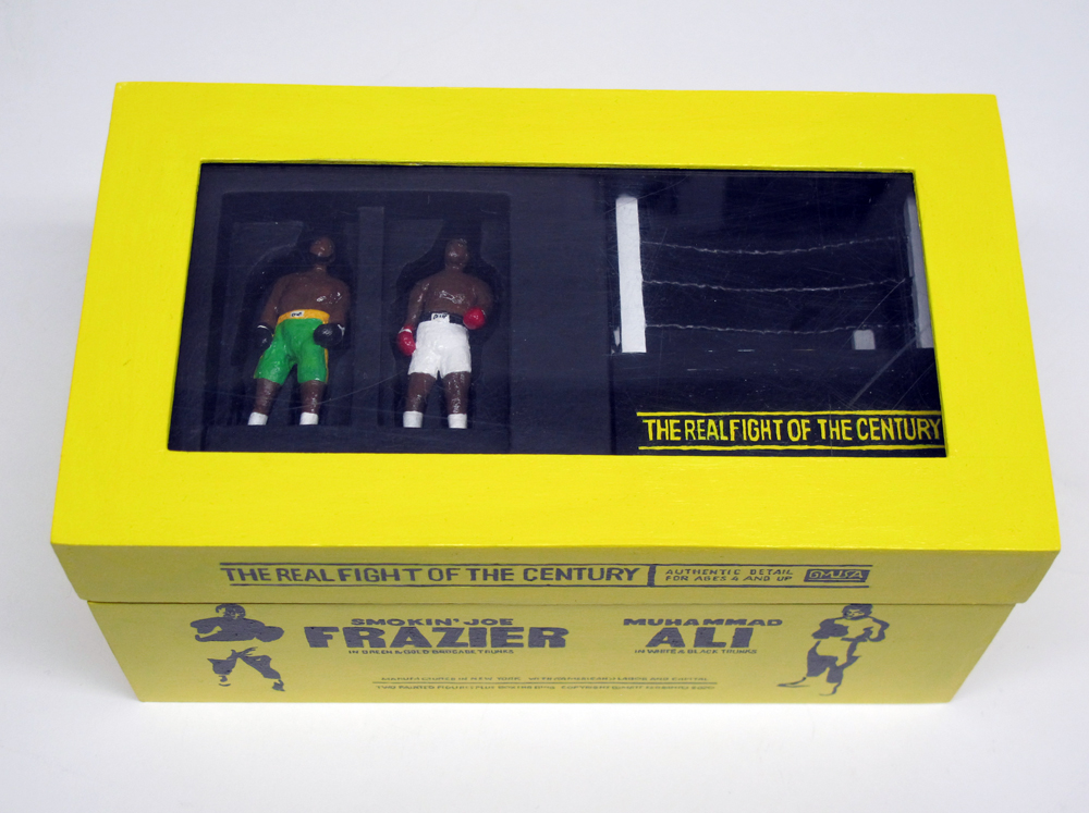 "closed box of ""The Real Fight of the Century,"" boxed set with two painted figures plus boxing ring by Matt Ferranto"