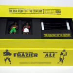 "open box with lid of ""The Real Fight of the Century,"" boxed set with two painted figures plus boxing ring by Matt Ferranto"