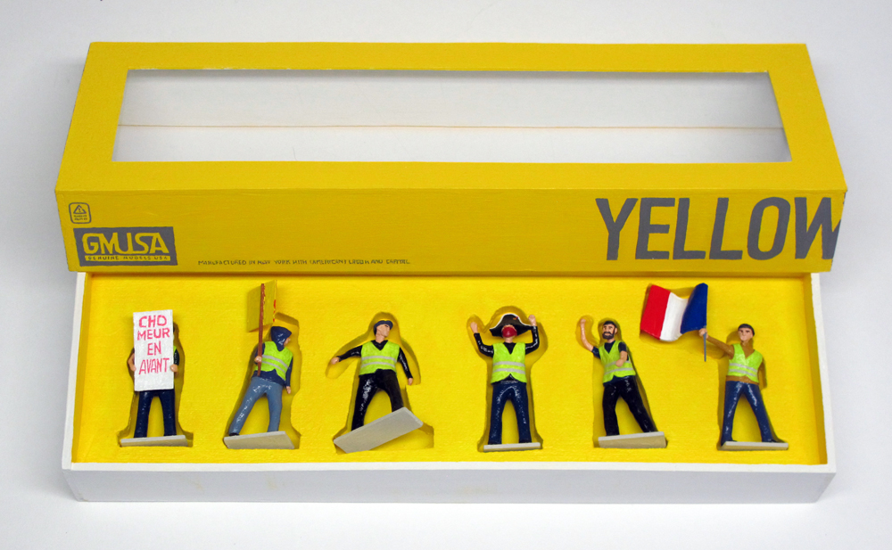 "open box of ""Yellow Vests (Gilets Jaunes),"" boxed set with six painted figures by Matt Ferranto"