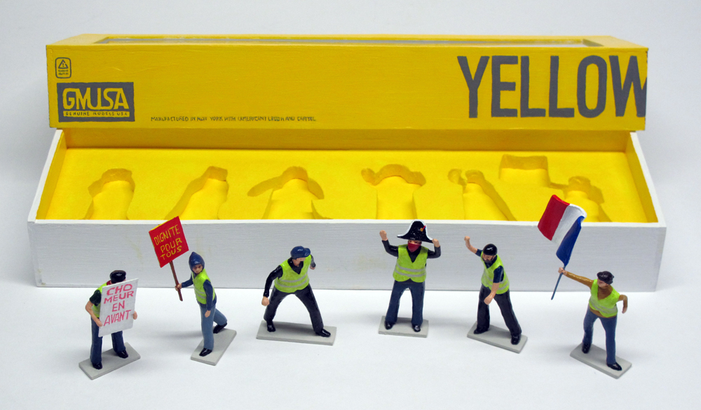 "opened box of ""Yellow Vests (Gilets Jaunes),"" boxed set with six painted figures by Matt Ferranto"