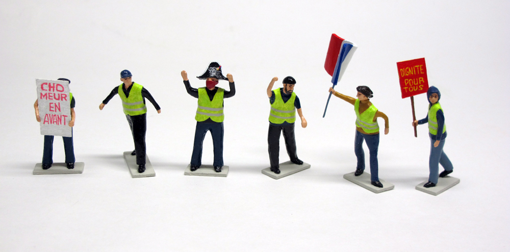 "figure set of ""Yellow Vests (Gilets Saunes),"" boxed set with six painted figures by Matt Ferranto"