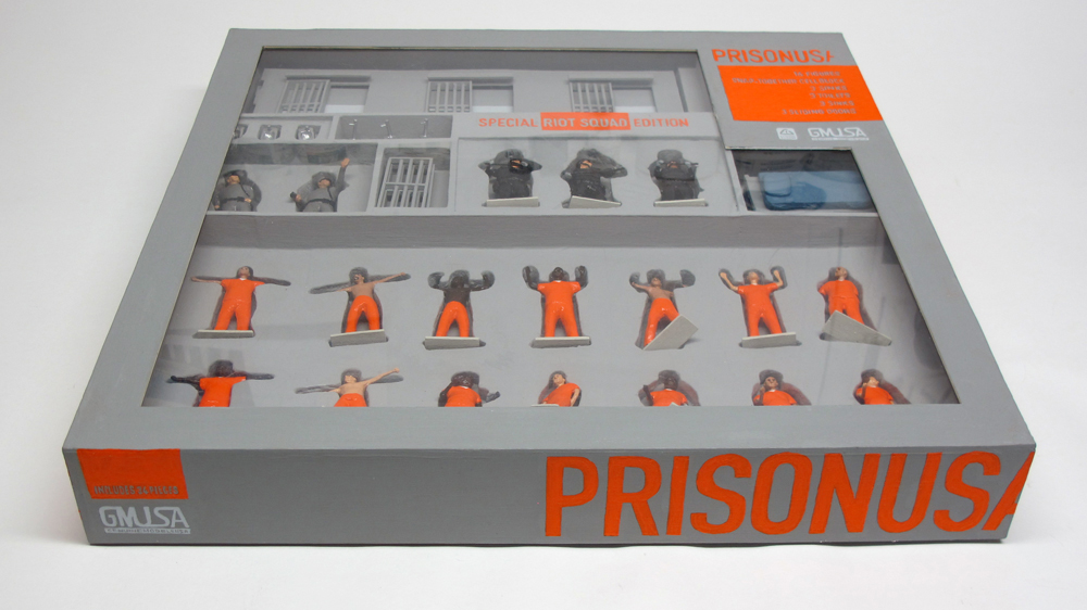 "closed box with lid of ""PrisonUSA,"" boxed set with 19 painted figures plus accessories by Matt Ferranto"