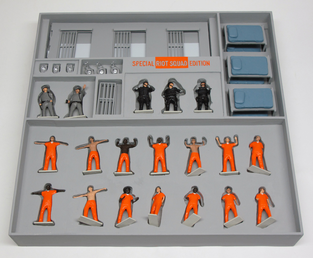 "open box of ""PrisonUSA,"" boxed set with 19 painted figures plus accessories by Matt Ferranto"