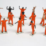 "all figures from ""PrisonUSA,"" boxed set with 19 painted figures plus accessories by Matt Ferranto"