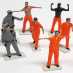 "detail of guard and prisoner figures from ""PrisonUSA,"" boxed set with 19 painted figures plus accessories by Matt Ferranto"