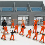 "figures + cell block of ""PrisonUSA,"" boxed set with 19 painted figures plus accessories by Matt Ferranto"
